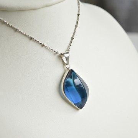Natural Blue Amber Pendant...