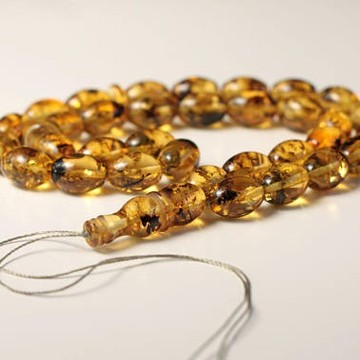 Baltic Amber Beads with Plants 29.93 grams olive beads light tea