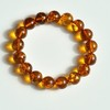 image 0 image 1 image 2 image 3 image 4 Natural Baltic Amber Beaded Bracelet, 12.5 mm Orange Amber Polished Round Beads
