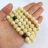 Milky White / Red Cherry Baltic Amber Buddhist Prayer Beads bead diameter: 10.5 mm Weight: 53.05 grams